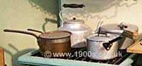 Various old aluminium and copper cooking pots