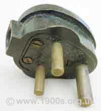Old round pin electric plug for a wall socket, 1940s and 1950s UK