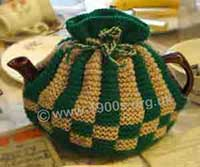 old knitted tea cosy to keep the tea in a teapot hot