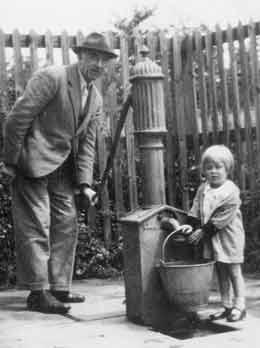 Getting water from a pump, early 1940s