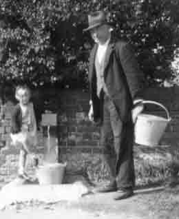 Getting water from a standpipe, early 1940s